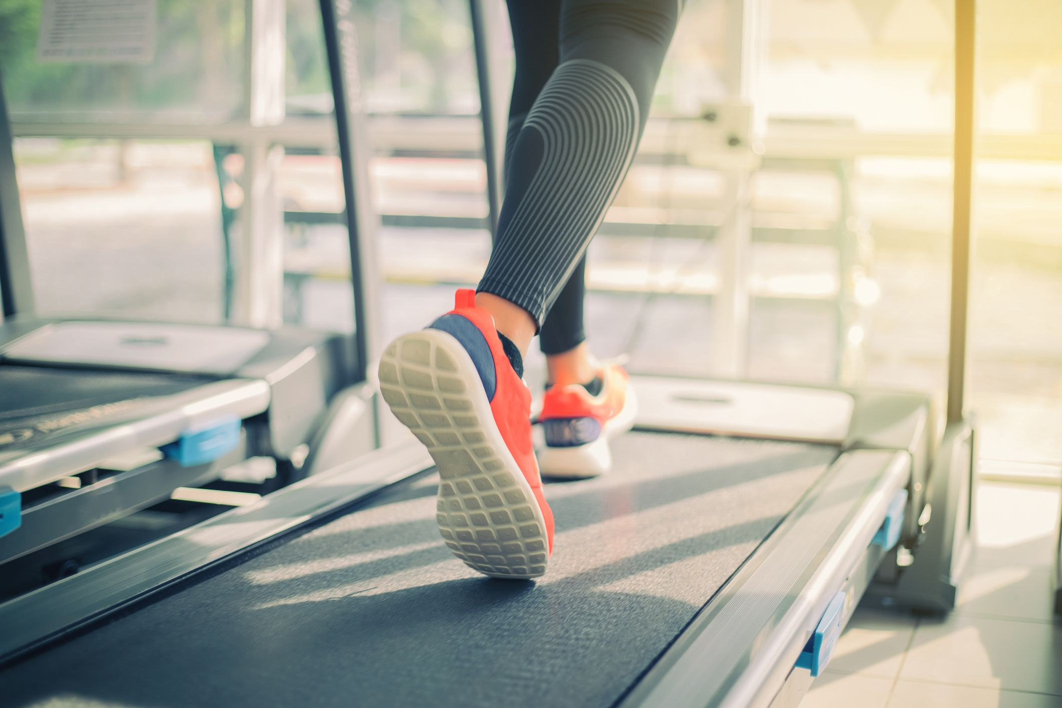 low-section-of-woman-running-on-treadmill-in-gym-royalty-free-image-925832428-1567696446